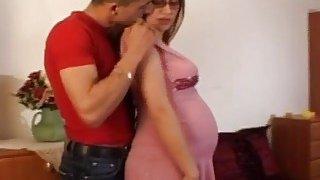 Pregnant amateur brunette gets pounded by big dick