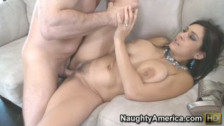 Tatted Raylene with hairy pussy fucking on a white couch as a real bad girl