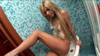 Slim blond wanker Adaline masturbates on the toilet bowl